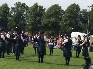 Pipers and drummers doing their thing as runners cross the finish line