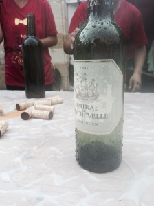 A soggy bottle of Amiral at the Chateau Beychevelle wine stop 33km into the race